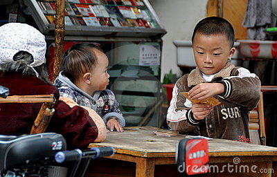 Pengzhou, China: Boy Playing Cards Editorial Stock Photo