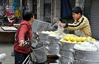 Pengzhou, China: Boy Selling Dumplings Editorial Photo