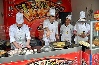 Pengzhou, China: Chefs Cooking Pastries Editorial Image