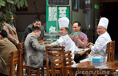 Pengzhou, China: Chefs Playing Cards Editorial Image