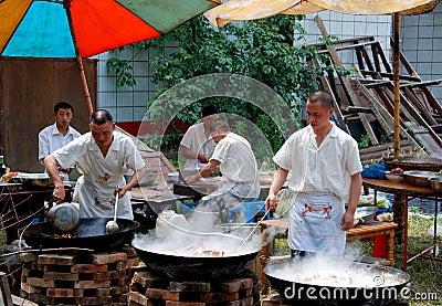 Pengzhou, China: Chefs with Woks Editorial Photo