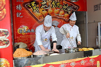 Pengzhou, China: Chefs at Work Editorial Photo