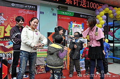 Pengzhou, China: Children at Store Sales Event Editorial Stock Image
