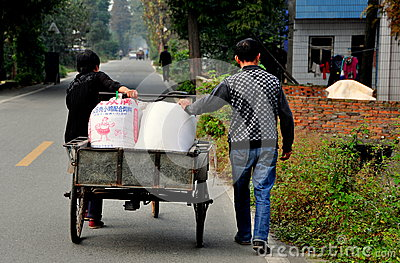 Pengzhou, China: Chinese Farmers with Bicycle Cart Editorial Photography
