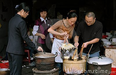 Pengzhou, China: Cooks at Restaurant Editorial Stock Photo