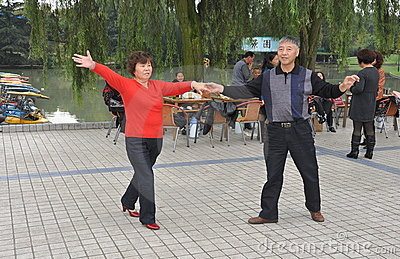 Pengzhou, China: Couple Dancing in Pengzhou Park Editorial Stock Image