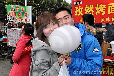 Pengzhou, China: Couple Sharing Cotton Candy Editorial Photo