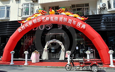 Pengzhou, China: Dragon Arch at Store Opening Editorial Photography