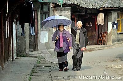 Pengzhou, China: Elderly Couple on Hua Lu Street Editorial Photo