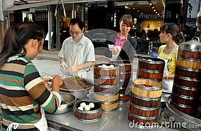 Pengzhou, China: Family Selling Dumplings Editorial Image