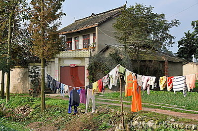 Pengzhou, China: Farm House with Laundry Editorial Stock Photo