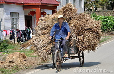 Pengzhou, China: Farmer on Bicycle Editorial Image