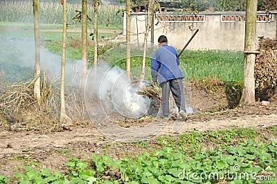 Pengzhou, China: Farmer Burning Refuse Editorial Image