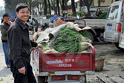 Pengzhou, China: Farmer at Market Co-op Editorial Photo