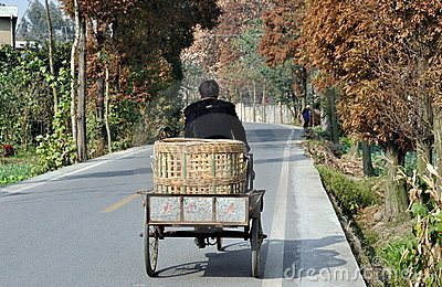 Pengzhou, China: Farmer Pedalling on Country Road