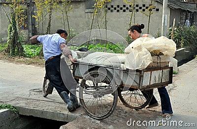 Pengzhou, China: Farmers Pushing Cart Editorial Photo