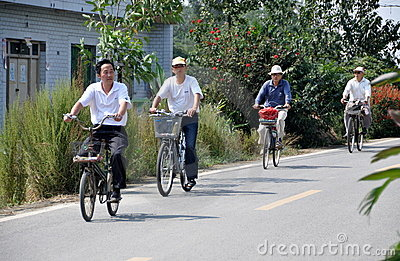 Pengzhou, China: Four Men Bicycling Editorial Stock Photo