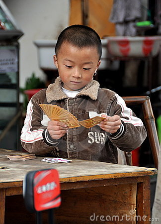 Pengzhou, China: Little Boy Playing Cards Editorial Stock Photo