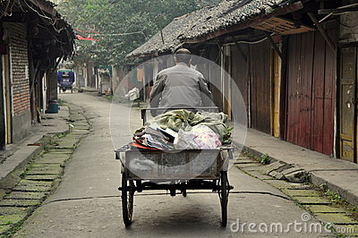 Pengzhou, China: Man in Bicycle Cart on Hua Lu Editorial Stock Image