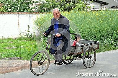 Pengzhou, China: Man and Boy on Bicycle Cart