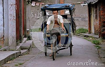 Pengzhou, China: Man Driving Bicycle Taxi Editorial Stock Image