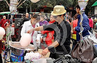 Pengzhou, China: Man Making Cotton Candy Editorial Stock Photo