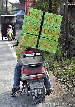Pengzhou, China: Man on Motorcycle with Packages