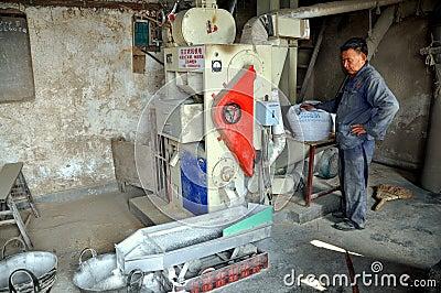 Pengzhou, China: Man Processing Rice
