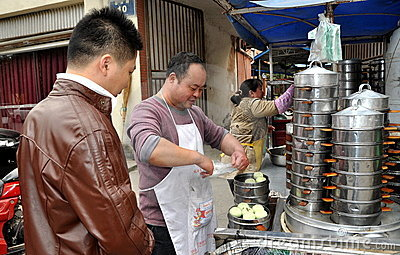 Pengzhou, China: Man Selling Bao Zi Dumplings Editorial Photography
