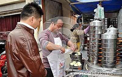 Pengzhou, China: Man Selling Bao Zi Dumplings Editorial Photography