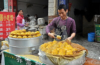 Pengzhou, China: Man Selling Dumplings Editorial Stock Image