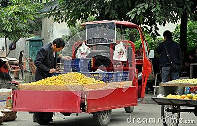 Pengzhou, China: Man Selling Oranges Editorial Photography
