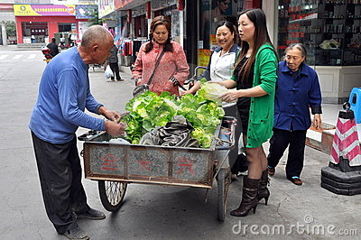 Pengzhou, China: Man Selling Vegetables Editorial Stock Photo
