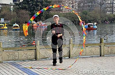 Pengzhou, China: Man Spinning Ti Huang Top