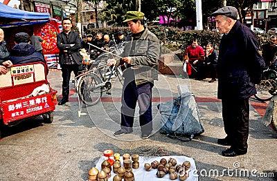 Pengzhou, China: Man Spinning Top