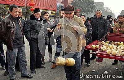 Pengzhou, China: Man with Ti Huang Top