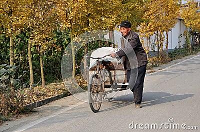 Pengzhou, China: Man Walking Bicycle Cart