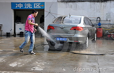 Pengzhou, China: Man Washing Car Editorial Stock Photo