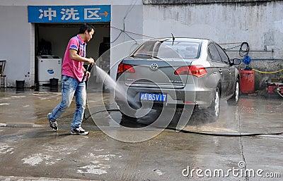 Pengzhou, China: Man Washing Car