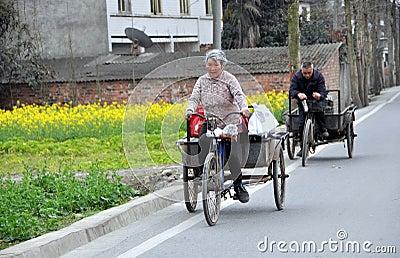 Pengzhou, China: Man & Wife Riding Bicycle Carts