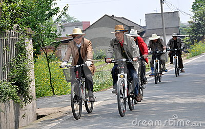 Pengzhou, China:  Men Biking on Country Road Editorial Photo