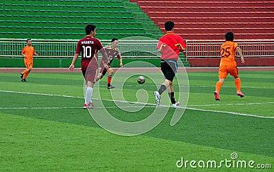 Pengzhou, China: Men Playing Football