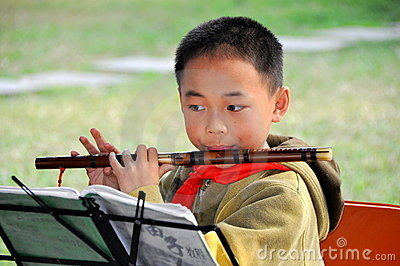 Pengzhou, China: Music Student with Flute Editorial Stock Photo