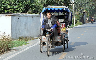 Pengzhou, China: Pedicab and Driver Editorial Stock Image