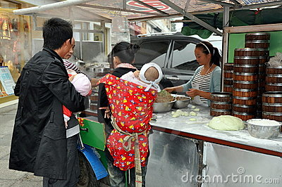 Pengzhou,China: People Buying Street Food Editorial Photography