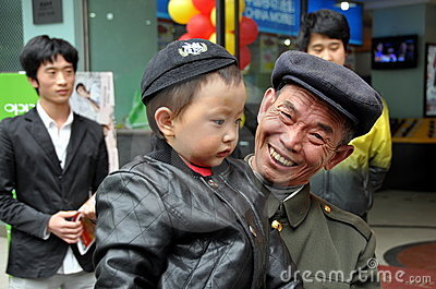 Pengzhou, China: Proud Smiling Grandpa with Baby Editorial Image