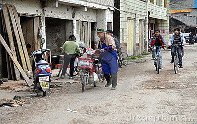 Pengzhou, China: Street Scene and Bicyclists Editorial Stock Photo
