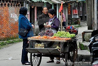 Pengzhou, China: Street Vendor Selling Fruits Editorial Stock Photo