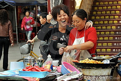 Pengzhou, China: Street Vendors Selling Food Editorial Image