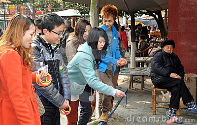 Pengzhou, China: Teens at Amusement Park Editorial Stock Photo